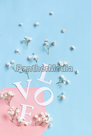 flowers pink envelope and word love