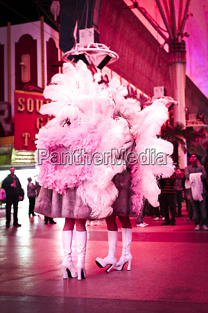 performers covered in feathers on fremont