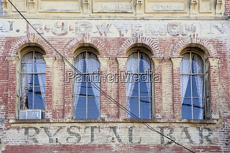 faded writing on the brick exterior