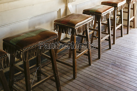 leather covered stools in a saloon