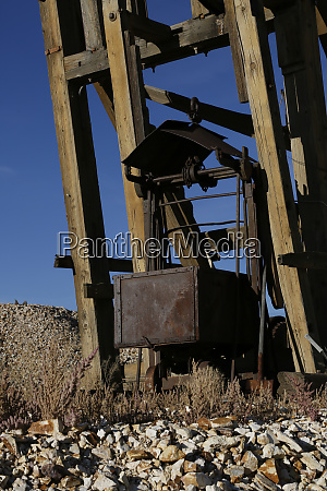 abandoned antique mining cart and equipment