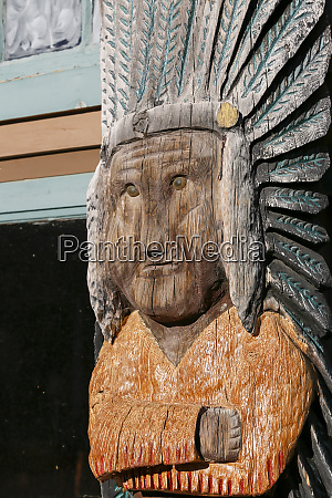 wooden carved sculpture styled after a