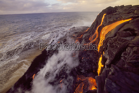 lava flowing to meet the sea