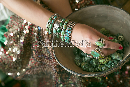 woman model showing off turquoise bracelets