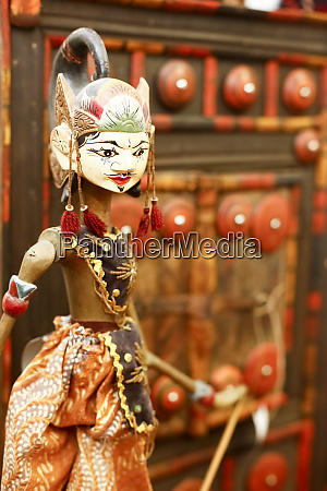 vintage indonesian puppet in consignment store