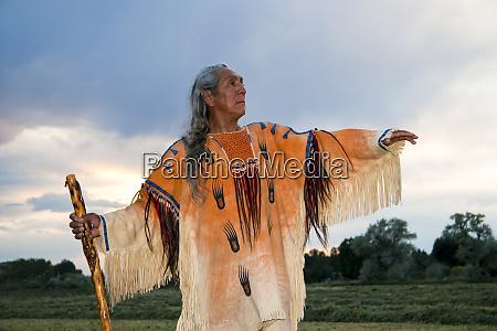 native american medicine man dressed in