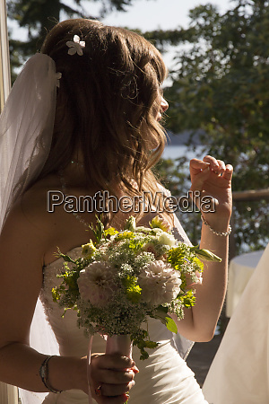 young bride with bouquet of flowers