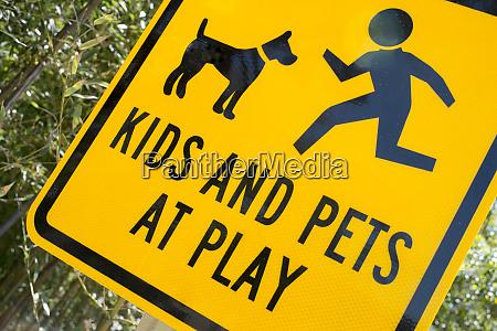 kids and pets at play warning