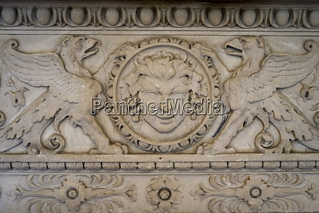 ornate carving on the side of