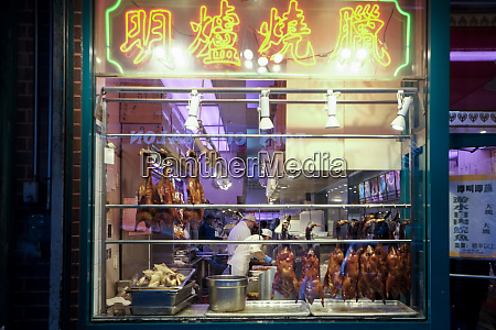 cooked duck hanging in the window