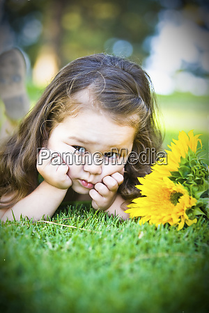 a cute young girl poses for