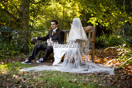 a bride and groom take a