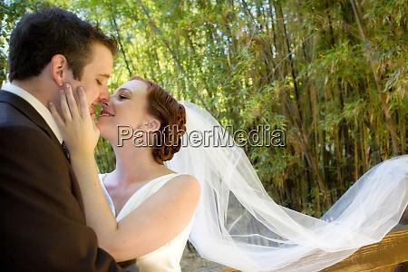 a groom kisses his bride mr