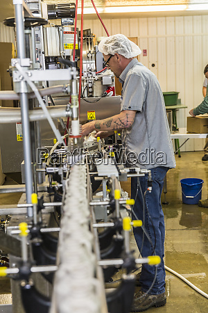 owner fabian lariviere works the bottling