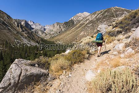 backpacker on big pine lakes trail