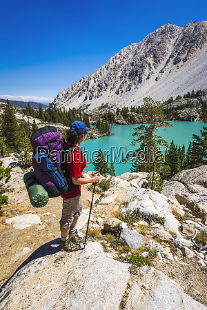 backpacker at first lake big pine