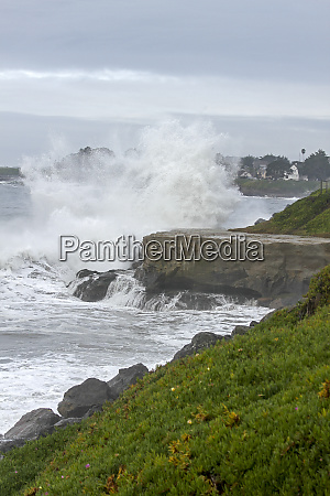 waves break against cliffs santa cruz