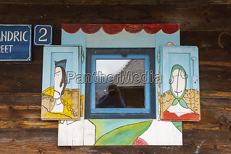 cabin with painted window mecavnik serbia