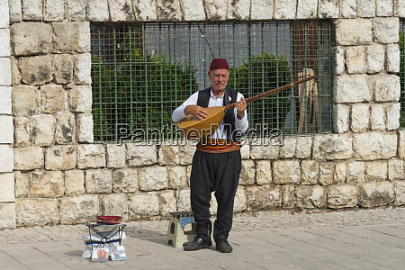 musician playing music instrument on the