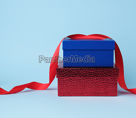square blue and red cardboard boxes