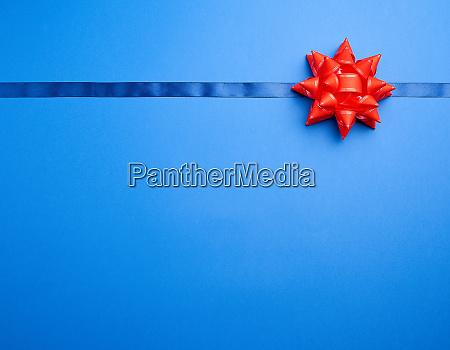 dark blue silk ribbon and a