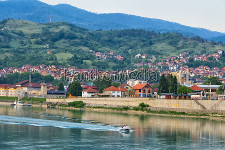 houses on the riverbank of the