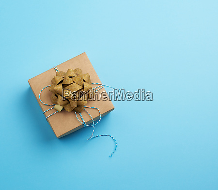brown square box with a gift