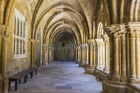 portugal coimbra old cathedral cloister archways