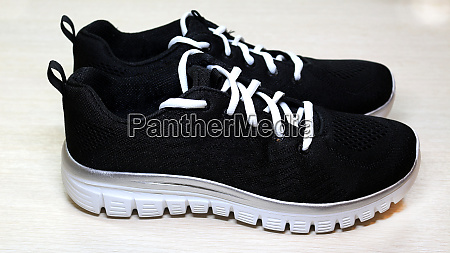 black sport unisex sneakers with white