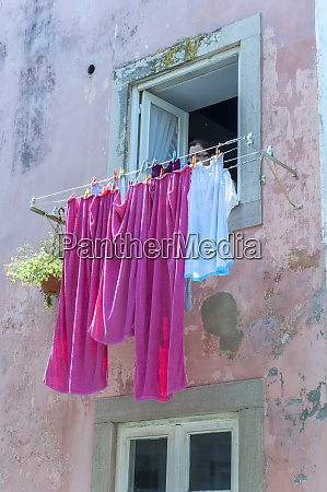 europe portugal sintra woman hanging laundry