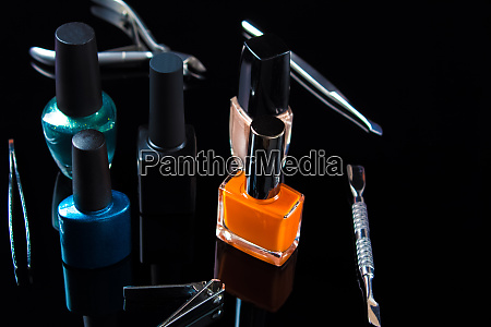 manicure and pedicure tools on black