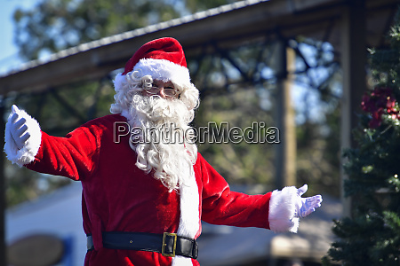 santa claus welcomes with open arms