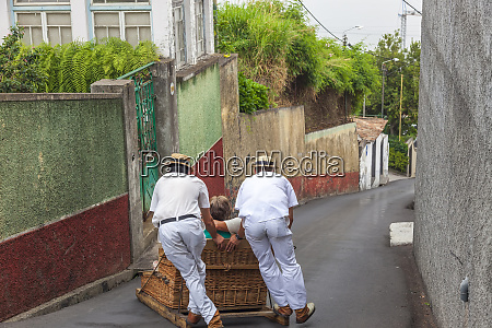 toboggans or wicker sledges or baskets