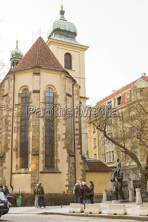 czech republic prague tourists gather by