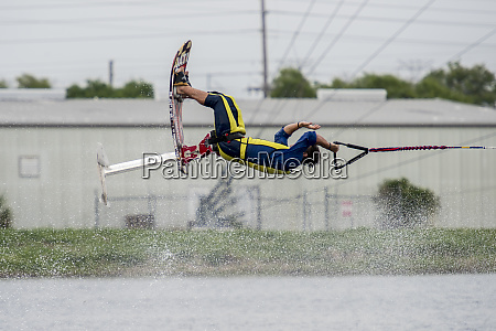 seated water skier flipping in the