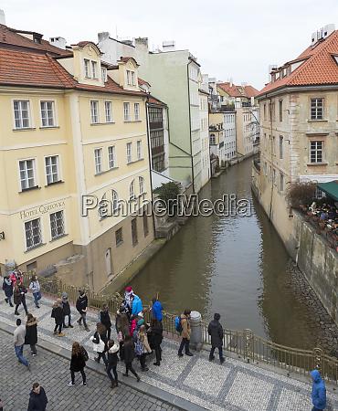 czech republic prague tourists walk along