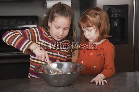 sisters stirring cookie dough mr pr