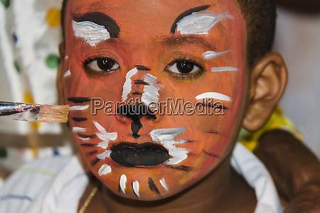putting makeup for carnival salvador unesco