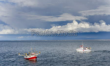 fishing boats heading towards keflavik harbor