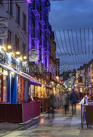 vibrant quay street at dusk in