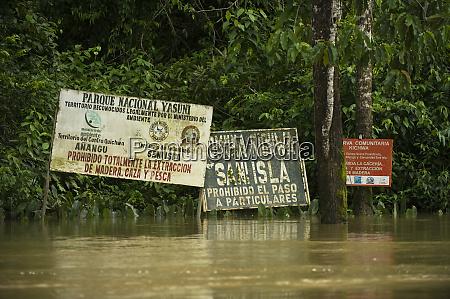 community signs on tiputini river bordering