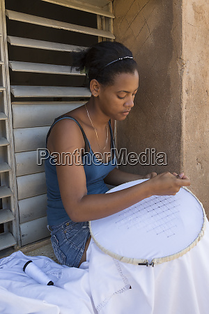 cuba trinidad a woman works on