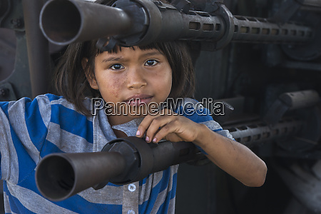 kid on military gun mabaruma guyana