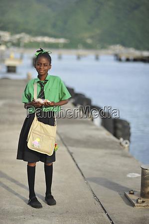 dominica roseau schoolgirl walking on pier