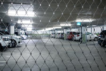 gated underground parking cars parked in