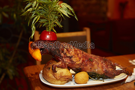 cuy roasted guinea pig at restaurant
