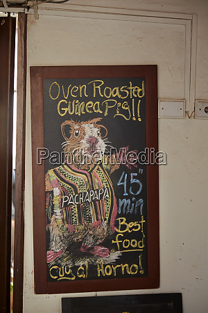 sign at restaurant selling cuy roasted
