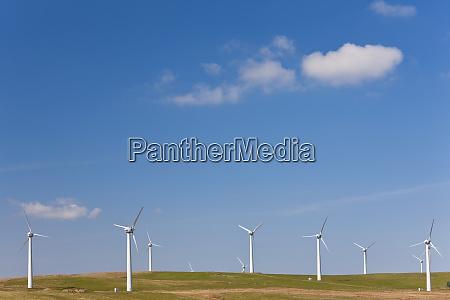 wind turbines on wind farm mid