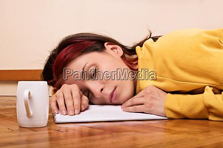 young girl fell asleep while studying
