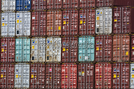 shipping containers stacked in port in